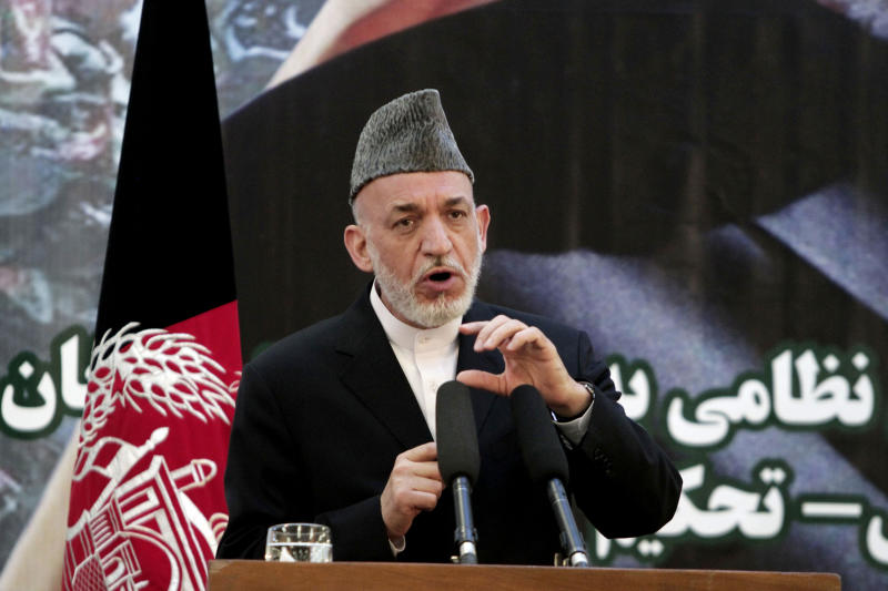 Afghan President Hamid Karzai speaks at a press conference during a ceremony at a military academy on the outskirts of Kabul, Afghanistan, Tuesday, June 18, 2013. Afghan forces have taken over the lead from the U.S.-led NATO coalition for security nationwide, Karzai announced in the significant milestone in the 12-year war. (AP Photo/Rahmat Gul)