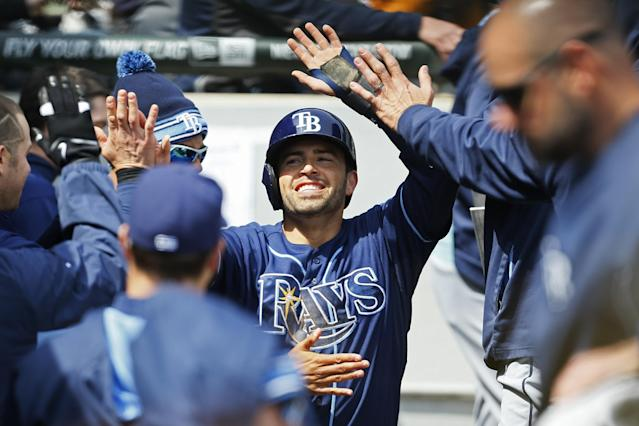 Tampa Bay Rays' David DeJesus, center, celebrates after scoring against the Chicago White Sox during the fifth inning of a baseball game on Sunday, April 27, 2014, in Chicago. (AP Photo/Andrew A. Nelles)