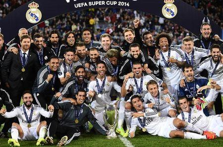 Real Madrid team members pose after winning the UEFA Super Cup final against Sevilla at Cardiff City stadium