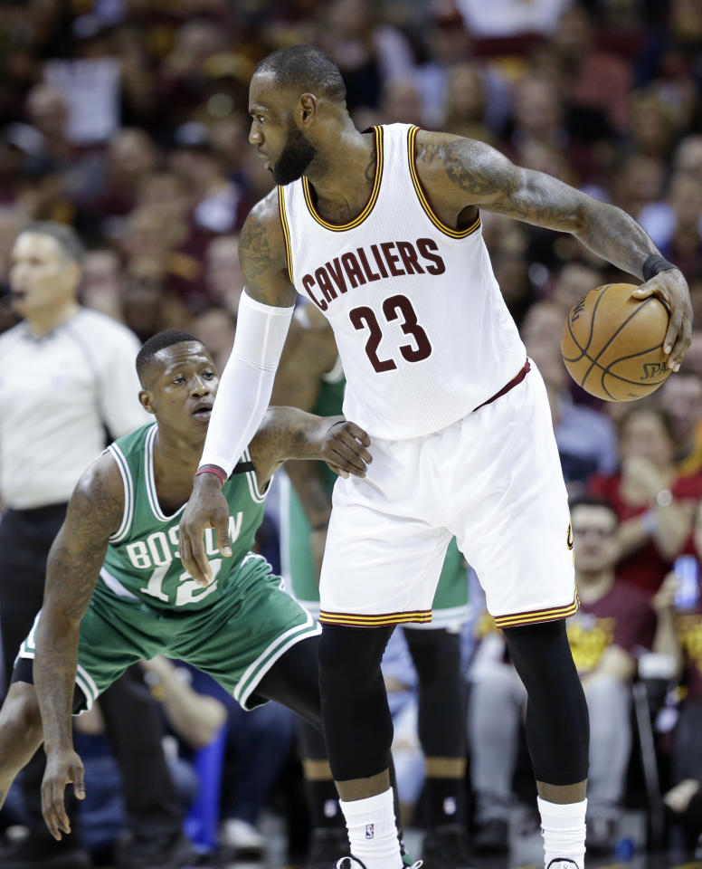 Cleveland Cavaliers' LeBron James (23) looks to drive on Boston Celtics' Terry Rozier (12) during the first half of Game 4 of the NBA basketball Eastern Conference finals, Tuesday, May 23, 2017, in Cleveland. (AP Photo/Tony Dejak)