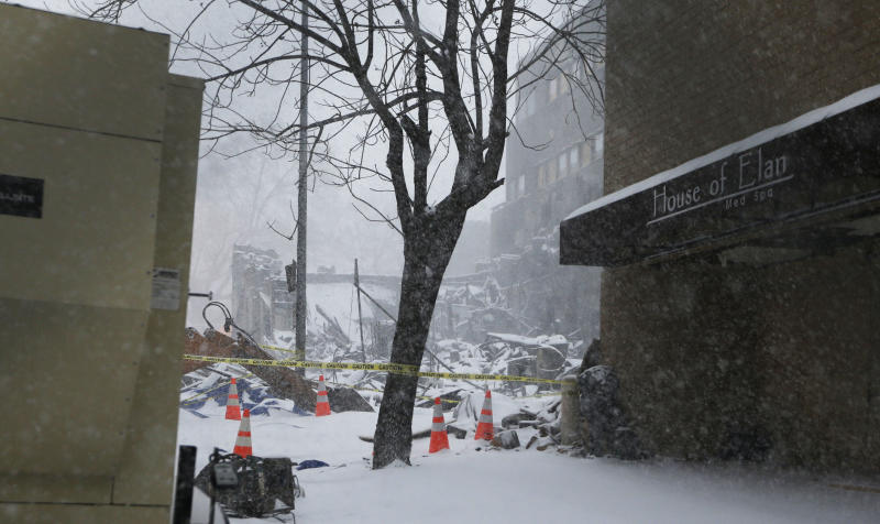 Snow falls on the burned out remains of JJ's in the Country Club Plaza shopping district of Kansas City, Mo., Thursday, Feb. 21, 2013.  The fire killed one person and injuring over a dozen. (AP Photo/Orlin Wagner)