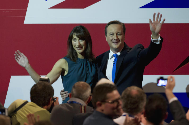 Britain's Prime Minister, David Cameron and his wife Samantha wave, after delivering his keynote speech on the final day of the Conservative Party Conference, in Manchester, England, Wednesday, Oct. 2, 2013. (AP Photo/Jon Super)