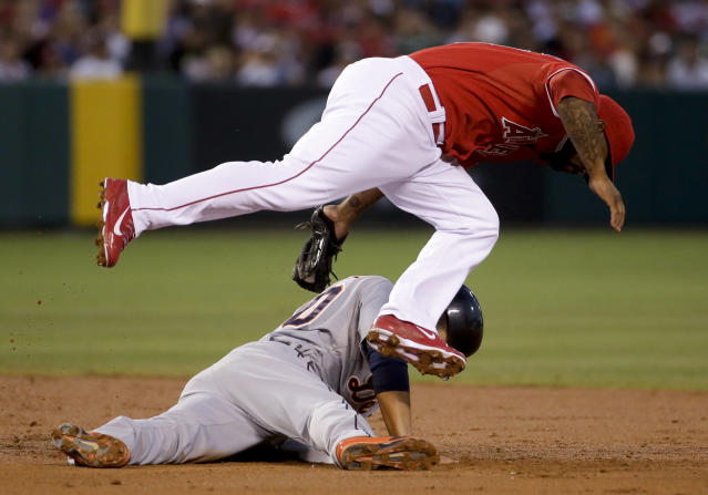 Los Angeles Angels second baseman Howie Kendrick, top, tags out Detroit Tigers' Eugenio Suarez at second after trying to steal during the third inning of a baseball game in Anaheim, Calif., Friday, July 25, 2014. (AP Photo/Chris Carlson)