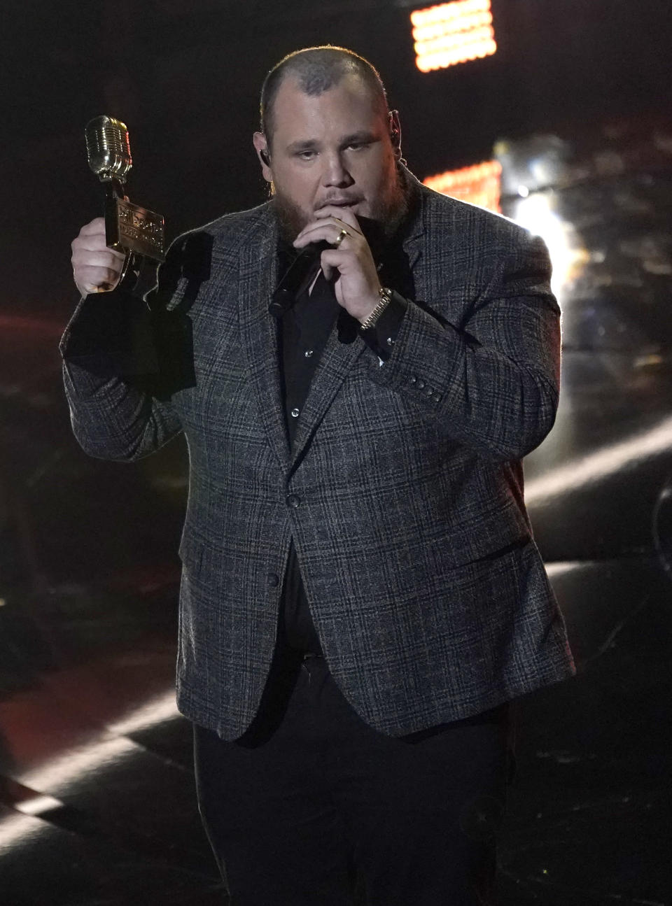 Luke Combs accepts the award for top country artist at the Billboard Music Awards on Wednesday, Oct. 14, 2020, at the Dolby Theatre in Los Angeles. (AP Photo/Chris Pizzello)