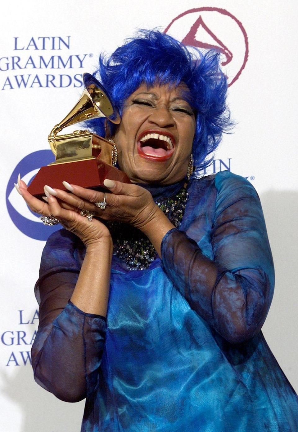 <p>Cruz strikes a poses with her Grammy for Best Salsa Performance at the 1st Annual Latin Grammy Awards. She's grinning from ear to ear holding her prize on the red carpet.</p>