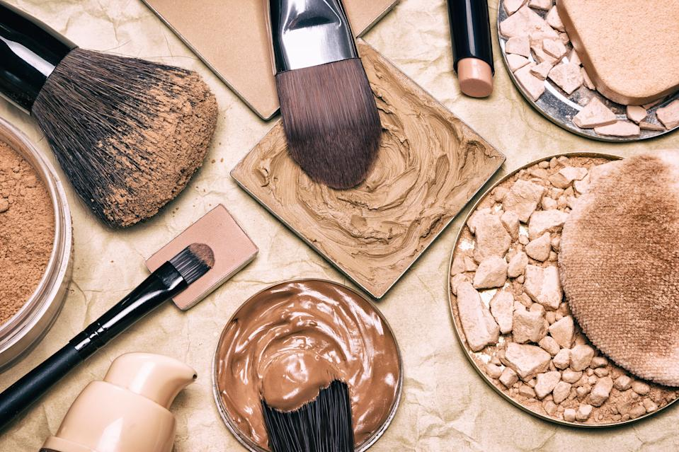 Makeup products to even skin tone and complexion on aged paper. Corrector, loose and compact powders, concealer pencil, liquid foundation with brushes and cosmetic sponges. Retro style processing