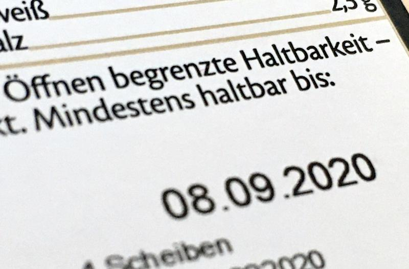 27 June 2020, Berlin: The best before date is printed on a cheese package. In the fight against the unnecessary throwing away of food, trade and consumer protectors are sceptical about fundamental changes to the best-before date (MHD). Photo: Kathrin Deckart/dpa (Photo by Kathrin Deckart/picture alliance via Getty Images)