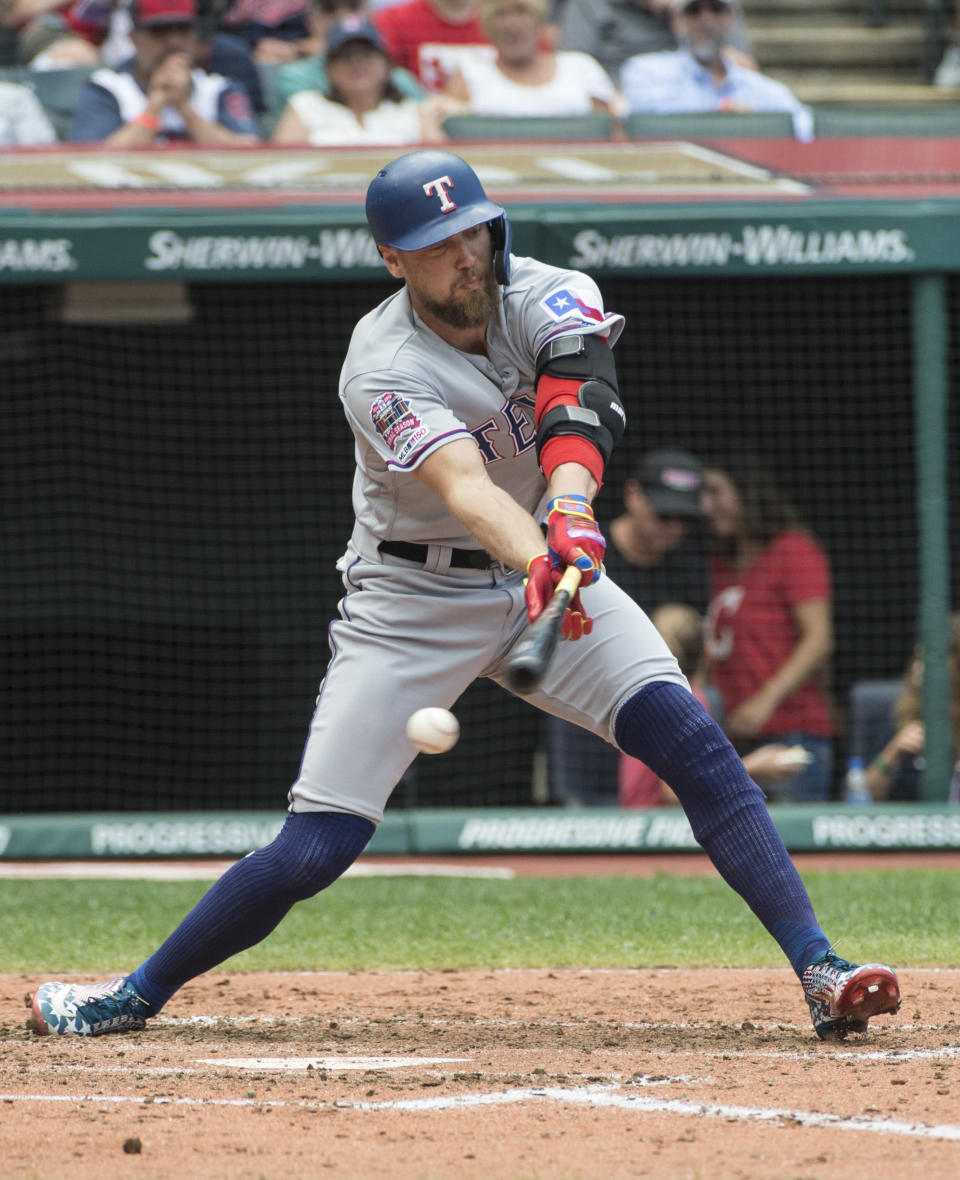 Texas Rangers' Hunter Pence can't check his swing on a pitch by Cleveland Indians starting pitcher Zach Plesac and strikes out during the third inning of the first game of a baseball doubleheader in Cleveland, Wednesday, Aug. 7, 2019. (AP Photo/Phil Long)