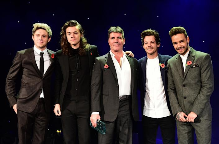 Simon Cowell with One Direction, a group he helped found, in 2015 (Ian West/PA Archive/PA Images)