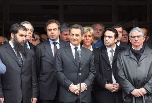 "France's incumbent President Nicolas Sarkozy (C), speaks in front of the ""Ozar Hatorah"" Jewish school where four people were shot dead"