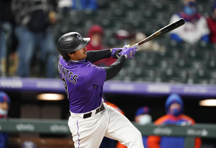 Colorado Rockies' Josh Fuentes watches his three-run home run off New York Mets relief pitcher Jacob Barnes during the fifth inning of the second game of a baseball doubleheader Saturday, April 17, 2021, in Denver. (AP Photo/David Zalubowski)