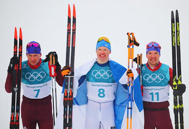 Cross-Country Skiing - Pyeongchang 2018 Winter Olympics - Men's 50km Mass Start Classic - Alpensia Cross-Country Skiing Centre - Pyeongchang, South Korea - February 24, 2018 - Winner Iivo Niskanen of Finland , flanked by Alexander Bolshunov, Olympic athlete from Russia, and Andrey Larkov, Olympic athlete from Russia, pose after finishing the race. REUTERS/Carlos Barria