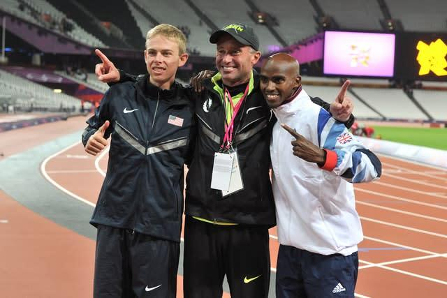 Sir Mo Farah, right, celebrates winning the 10,000m final with Galen Rupp, left, and Alberto Salazar (Martin Rickett/PA)
