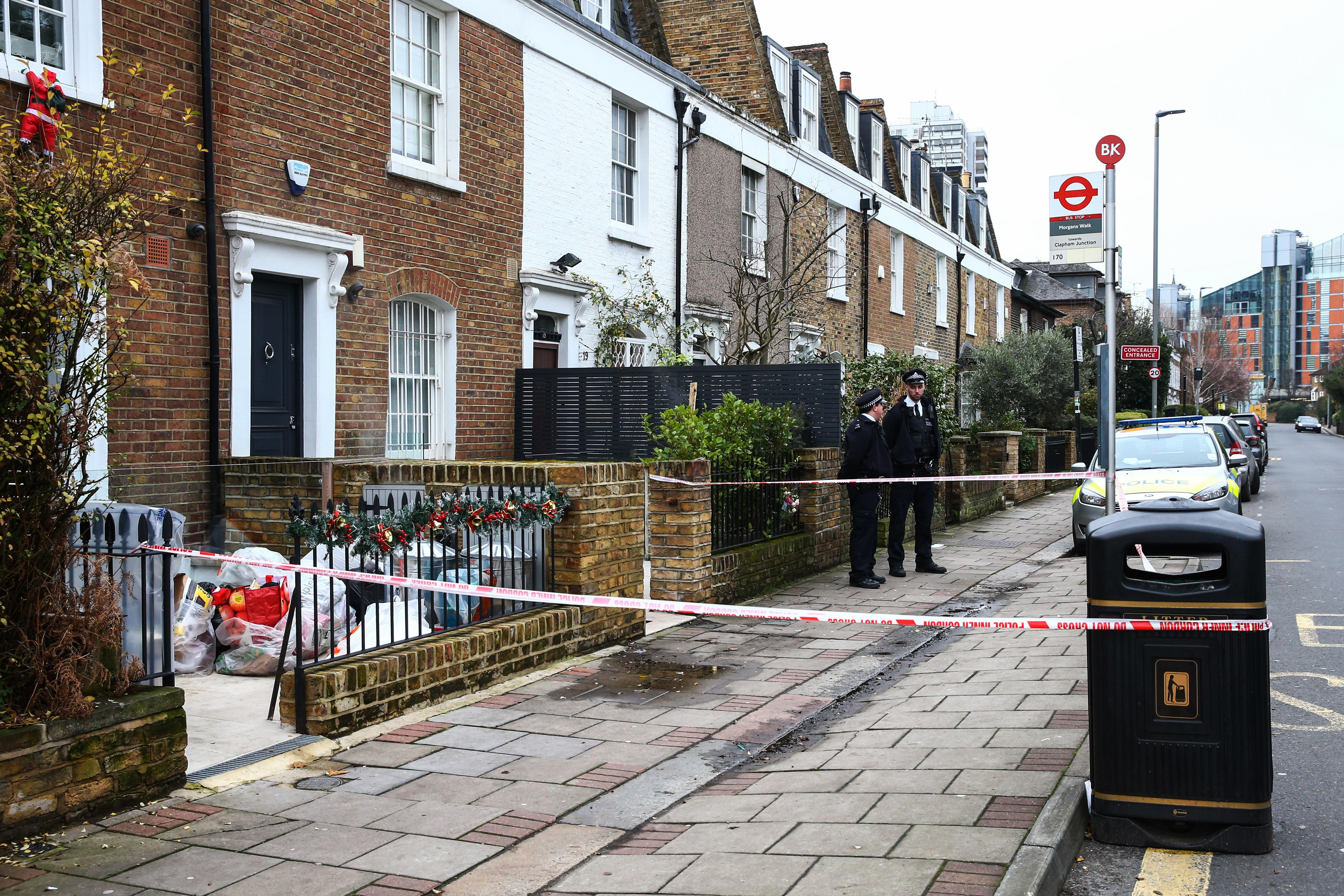 LONDON, ENGLAND - DECEMBER 27: Police stand outside the crime scene where Flamur Beqiri, 36, a father of one, was murdered on December 27, 2019 in south-west London, England. Beqiri was shot dead outside his home on Battersea Church Road on Christmas Eve. The Swedish national is the brother of former Real Housewives of Cheshire star Misse Beqiri. (Photo by Hollie Adams/Getty Images)