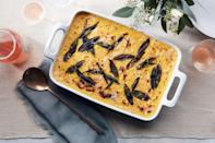 """Melty pockets of Fontina and sweet butternut squash make this Thanksgiving side dish super-comforting. <a href=""""https://www.epicurious.com/recipes/food/views/cheesy-baked-butternut-squash-polenta?mbid=synd_yahoo_rss"""" rel=""""nofollow noopener"""" target=""""_blank"""" data-ylk=""""slk:See recipe."""" class=""""link rapid-noclick-resp"""">See recipe.</a>"""