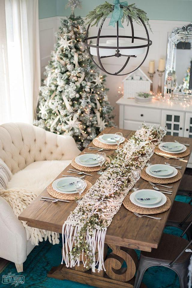 """<p>There's nothing more romantic than a little mistletoe and a string of sparkling lights around the holiday season—and both can be found in this pretty centerpiece.</p><p><strong>Get the tutorial at <a href=""""http://thediymommy.com/french-country-farmhouse-christmas-dining-room-table-setting/"""" rel=""""nofollow noopener"""" target=""""_blank"""" data-ylk=""""slk:The DIY Mommy"""" class=""""link rapid-noclick-resp"""">The DIY Mommy</a>.</strong></p><p><strong><a class=""""link rapid-noclick-resp"""" href=""""https://www.amazon.com/Sullivans-Artificial-Garland-Burgundy-Berries/dp/B01EZ994LW/?tag=syn-yahoo-20&ascsubtag=%5Bartid%7C10050.g.644%5Bsrc%7Cyahoo-us"""" rel=""""nofollow noopener"""" target=""""_blank"""" data-ylk=""""slk:SHOP MISTLETOE GARLAND"""">SHOP MISTLETOE GARLAND</a><br></strong></p>"""