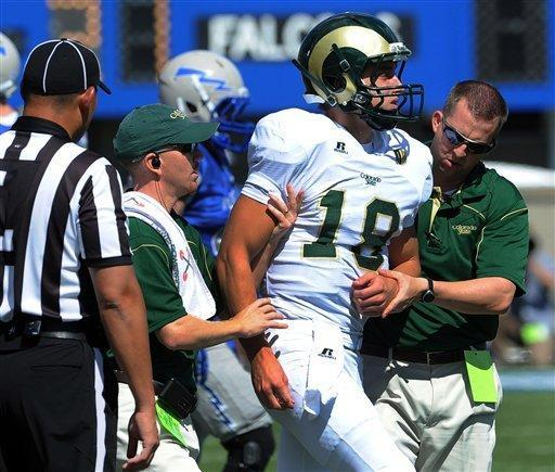 Colorado State quarterback Garrett Grayson is helped off the field after being injured during the first half of an NCAA college football game against Air Force at Air Force Academy, Colo. Sept. 29, 2012. Grayson left the game after the injury. (AP Photo/The Fort Collins Coloradoan, Rich Abrahamson)