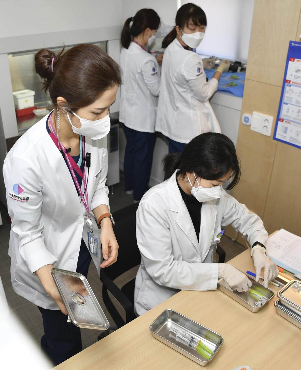 Nurses prepare for the first dose of the Pfizer BioNTech COVID-19 vaccine at the National Medical Center vaccination center in Seoul Saturday, Feb. 27, 2021. (Song Kyung-Seok/Pool Photo via AP)