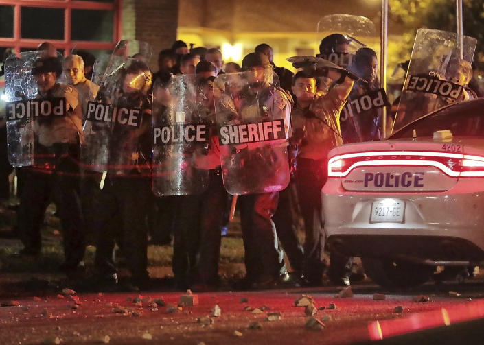 Shelby County Sheriff's deputies brace against the crowd as protesters take to the streets of the Frayser community in anger against the shooting a youth identified by family members as Brandon Webber by U.S. Marshals earlier in the evening, Wednesday, June 12, 2019, in Memphis, Tenn. (Photo: Jim Weber/Daily Memphian via AP)