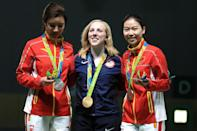 <p>(L-R) Li Du of China with silver, Virginia Thrasher of the United States with gold and Siling Yi of China with bronze pose on the podium following the Women's 10m Air Rifle on Day 1 of the Rio 2016 Olympic Games at the Olympic Shooting Centre on August 6, 2016 in Rio de Janeiro, Brazil. (Photo by Sam Greenwood/Getty Images) </p>