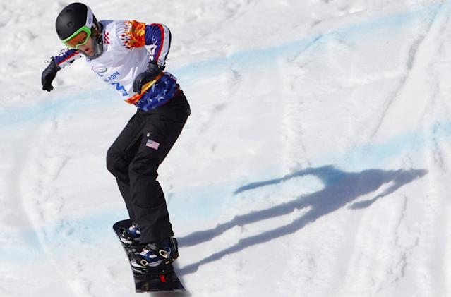 Amy Purdy of United States competes during the women's para snowboard cross, standing event at the 2014 Winter Paralympic, Friday, March 14, 2014, in Krasnaya Polyana, Russia. (AP Photo/Dmitry Lovetsky)