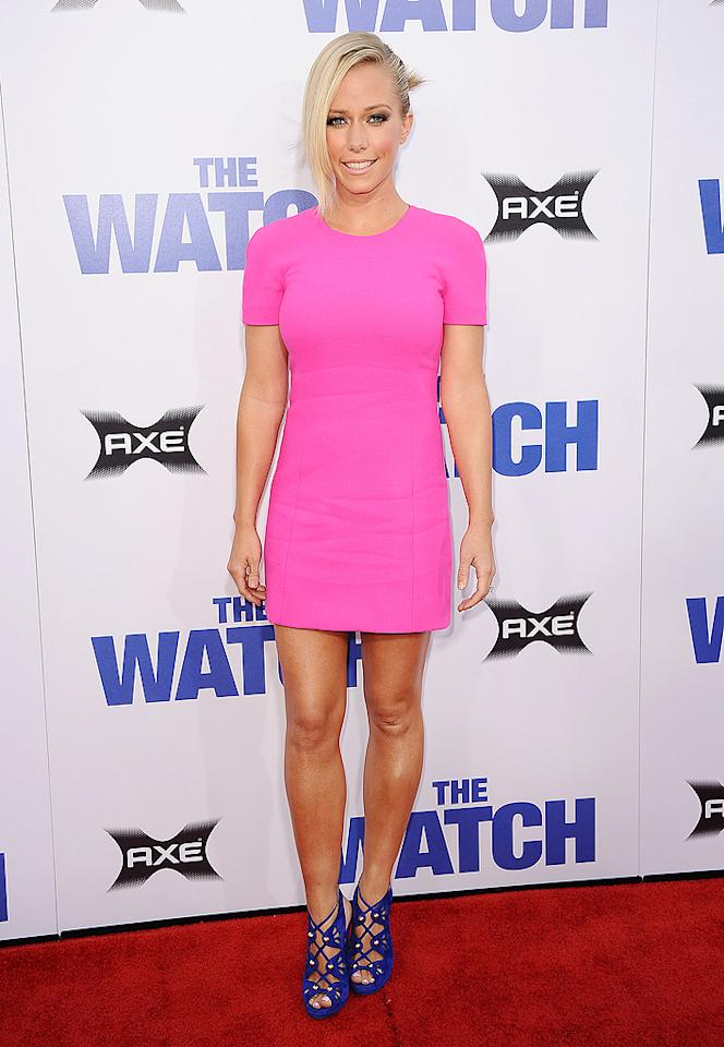 "Kendra Wilkinson looked better than ever upon arriving at the Los Angeles premiere of ""The Watch,"" held at the world-famous Grauman's Chinese Theatre on Monday evening. Wearing a simple-yet-chic, bubblegum-pink sheath, the former ""Girls Next Door"" star perfectly paired her mini with a rockin' asymmetrical 'do, barely-there makeup, and lace-up sandals. Hank Baskett is one lucky man! (7/23/2012) Follow 2 Hot 2 Handle creator, Matt Whitfield, on Twitter!"