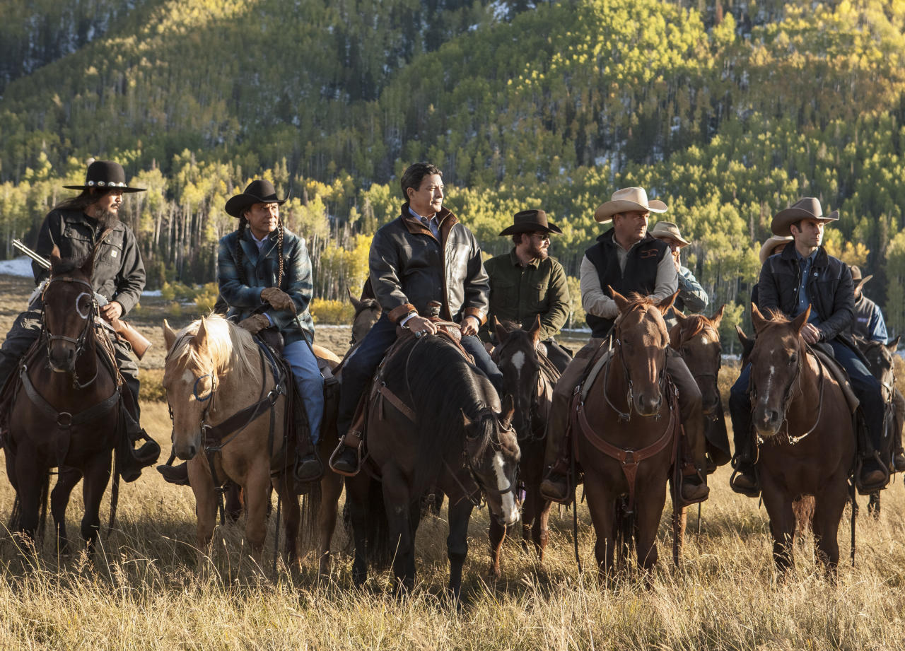"This image released by Paramount Network shows, from left, Pete Sands, Mo Brings Plenty, Gil Birmingham, Cole Hauser, Kevin Costner and Wes Bentley from the new series, ""Yellowstone,"" premiering Wednesday, June 20 on Paramount Network. (Emerson Miller/Paramount Network via AP)"
