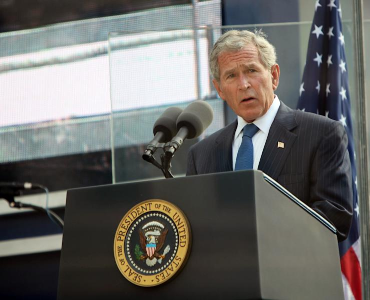 FILE - In this Sept. 11, 2011 file photo, former U.S. President George W. Bush addresses those attending the 10th anniversary commemoration of the terrorist attacks on the World Trade Center in New York. For the first time, elected officials won't be allowed to speak Tuesday, Sept. 11, 2012, at an occasion that has allowed them a solemn turn in the spotlight, a change made in the name of avoiding politics, but rapped by some as a political move in itself. (AP Photo/Allan Tannenbaum, Pool, File)
