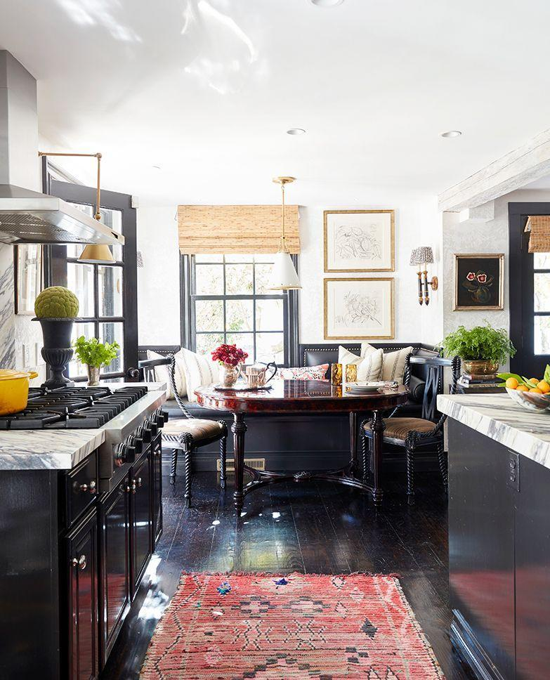 """<p>""""What I really wanted was a kitchen that felt like a library,"""" says designer <a href=""""http://www.bbromleyinteriors.com/"""" rel=""""nofollow noopener"""" target=""""_blank"""" data-ylk=""""slk:Brittany Bromley"""" class=""""link rapid-noclick-resp"""">Brittany Bromley</a> of this space. The dark wood stain create and inky black banquette a moody English countryside feel. The windows allow for plenty of light though, so it doesn't end up feeling dark and damp. Pro tip: If you want to build a banquette by a window, work around the existing frame instead of blocking light or messing too much with the bones of the space. </p>"""