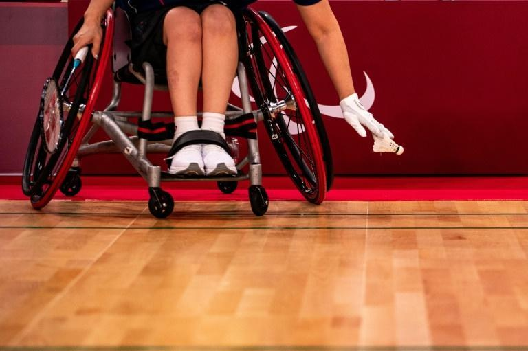 Wheelchair singles take place on a playing area just half the width of the court (AFP/Philip FONG)