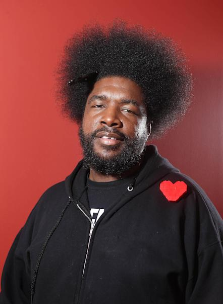 FILE - In this Dec. 8, 2011 file photo, musician Questlove from the band The Roots, poses for a portrait, in New York. Whoopi Goldberg teams up in October 2012 with celebrity chef, Art Smith, with help on tunes from Questlove, to serve up a couple dozen inspired takes on one of America's favorite fried foods, chicken. The event is part of the fifth annual New York City Wine and Food Festival. (AP Photo/Carlo Allegri, File)