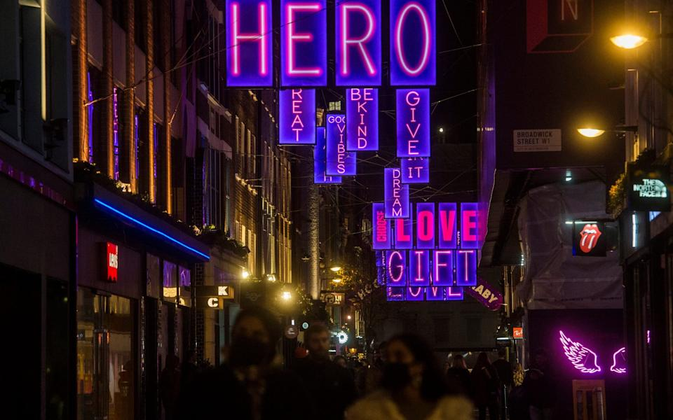 People under a Christmas light display on Carnaby Street in London - Kirsty O'Connor/PA Wire
