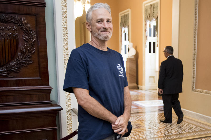 Jon Stewart, former host of The Daily Show, smiles at the Ohio Clock Corridor in the Capitol on Tuesday, July 23, 2019. The Senate will be voting later today on HR 1327: Never Forget the Heroes: Permanent Authorization of the September 11th Victim Compensation Fund Act. (Photo: Bill Clark/CQ Roll Call/Getty Images)