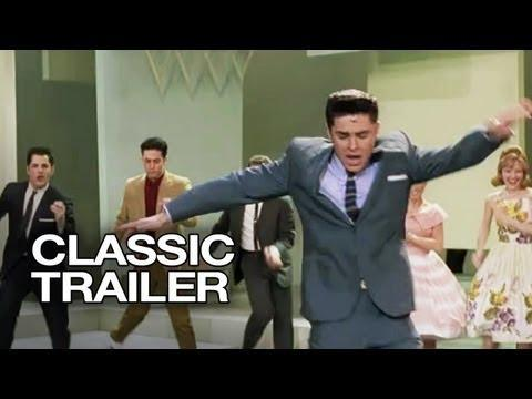 "<p>Efron is <em>very </em>much leaning into his <em>HSM </em>bonafides as singing and dancing heartthrob Link Larkin in the fun 2007 musical remake of <em>Hairspray, </em>appearing alongside a talented cast that includes John Travolta as Edna Turnblad.</p><p><a class=""link rapid-noclick-resp"" href=""https://play.hbomax.com/feature/urn:hbo:feature:GXjtShwFsq47CZgEAABBq"" rel=""nofollow noopener"" target=""_blank"" data-ylk=""slk:Stream It Here"">Stream It Here</a></p><p><a href=""https://www.youtube.com/watch?v=SUoG7mqCixI"" rel=""nofollow noopener"" target=""_blank"" data-ylk=""slk:See the original post on Youtube"" class=""link rapid-noclick-resp"">See the original post on Youtube</a></p>"
