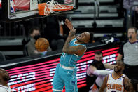 Charlotte Hornets guard Malik Monk (1) dunks against the Phoenix Suns during the second half of an NBA basketball game, Wednesday, Feb. 24, 2021, in Phoenix. (AP Photo/Matt York)