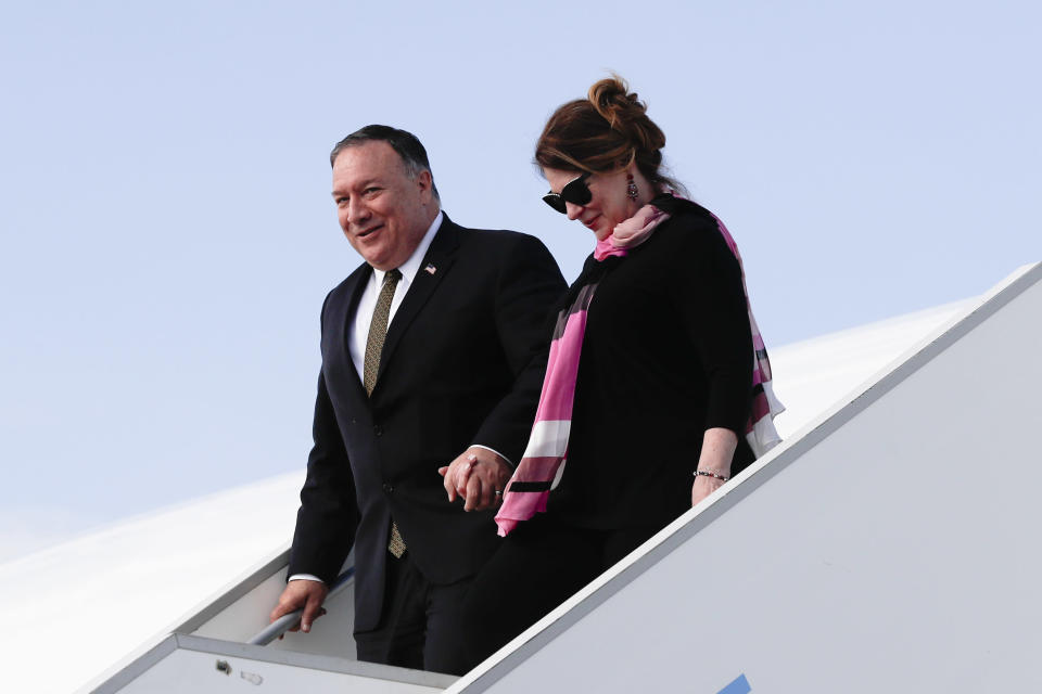 U.S. Secretary of State Mike Pompeo, left, arrives with his wife Susan Pompeo, right, at the airport in Prague, Czech Republic, Tuesday, Aug. 11, 2020. U.S. Secretary of State Mike Pompeo is in Czech Republic at the start of a four-nation tour of Europe. Slovenia, Austria and Poland the other stations of the trip. (AP Photo/Petr David Josek, Pool)
