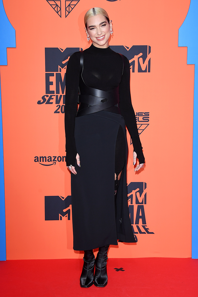 """<p>Remember when Dua wore this edgy black midi dress, complete with a strappy leather corset, for the <a href=""""https://www.cosmopolitan.com/uk/fashion/celebrity/a29681514/dua-lipa-mtv-emas-outfit/"""" rel=""""nofollow noopener"""" target=""""_blank"""" data-ylk=""""slk:2019 MTV EMAs"""" class=""""link rapid-noclick-resp"""">2019 MTV EMAs</a>?</p>"""