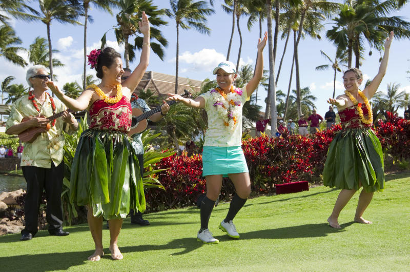 Ai Miyazato, center, of Japan dances the hula after winning the LPGA LOTTE Championship golf tournament at Ko Olina Golf Club Saturday, April 21, 2012, in Kapolei, Hawaii. (AP Photo/Eugene Tanner)