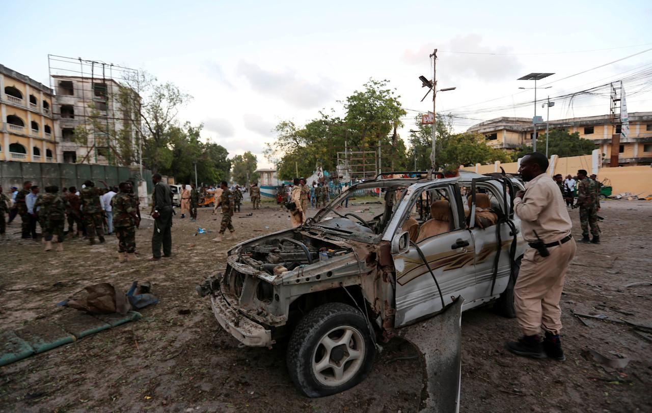 Somali security officers secure the scene of a suicide car explosion in front of the national theatre in Somalia's capital Mogadishu, March 21, 2017 REUTERS/Feisal Omar     TPX IMAGES OF THE DAY