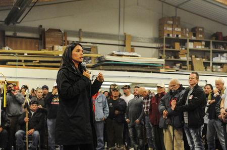 """FILE PHOTO: Tulsi Gabbard, Democratic Representative from Hawaii, speaks to veterans at a Sioux tribal welcome meeting at Sitting Bull College as """"water protectors"""" continue to demonstrate against plans to pass the Dakota Access pipeline near the Standing Rock Indian Reservation, in Fort Yates, North Dakota, U.S. December 3, 2016. REUTERS/Stephanie Keith/File Photo"""