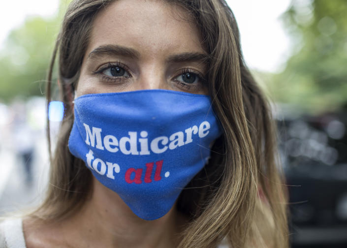 A woman wearing a face mask with Medicare for All written on it,  seen near the Capitol as she takes part in the March for Medicare for All in Washington D.C. on 7/24/2021. (Photo by Probal Rashid/LightRocket via Getty Images)