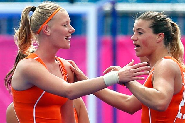 Netherlands' Kitty van Male (L) and Kim Lammers celebrate their team's victory after their women's Group A hockey match against Belgium at the London 2012 Olympic Games at the Riverbank Arena on the Olympic Park in London July 29, 2012. REUTERS/Suzanne Plunkett