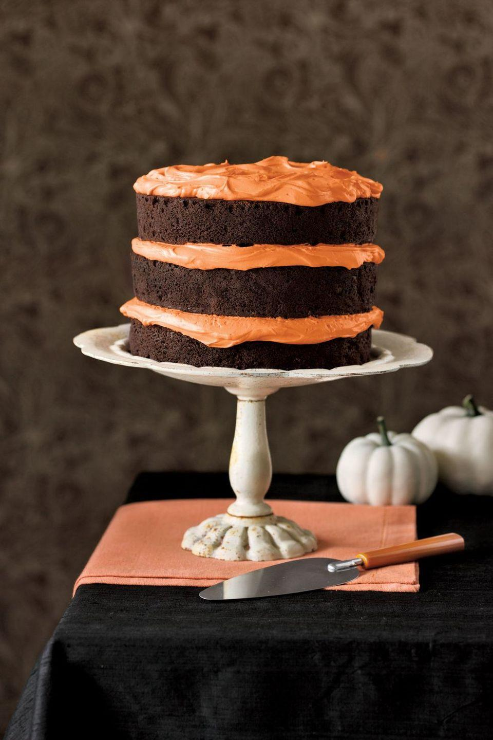 """<p>In between the chocolate cake tiers, add a thick layer of orange frosting for the ultimate Halloween cake.</p><p><em><a href=""""https://www.goodhousekeeping.com/food-recipes/a5721/chocolate-pumpkin-cake-cupcakes-3922/"""" rel=""""nofollow noopener"""" target=""""_blank"""" data-ylk=""""slk:Get the recipe for Chocolate Pumpkin Cake »"""" class=""""link rapid-noclick-resp"""">Get the recipe for Chocolate Pumpkin Cake »</a></em></p>"""