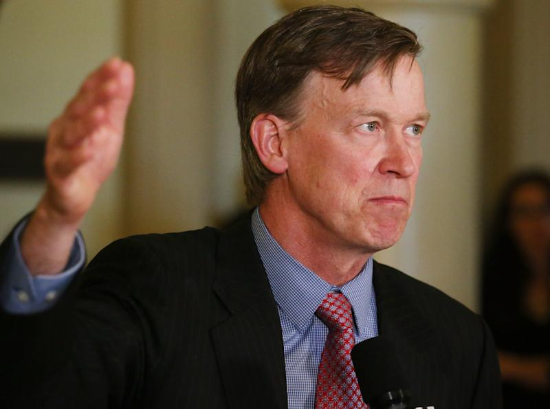 RETRANSMISSION TO CORRECT YEAR OF MURDERS - Colorado Gov. John Hickenlooper speaks at a news conference at the Capitol in Denver on Wednesday, May 22, 2013 where he announced that he was granting a temporary reprieve to Nathan Dunlap from his death sentence.  Dunlap was scheduled to be executed in August for the murders of four people in 1993 at a Chuck E. Cheese restaurant. (AP Photo/Ed Andrieski)