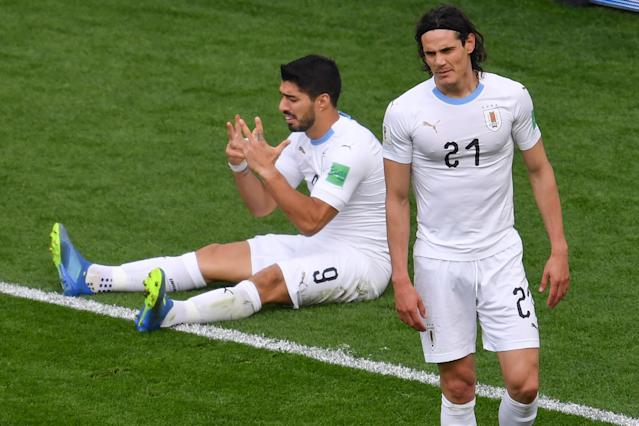 Luis Suarez sulks after missing a chance to score against Egypt while Edinson Cavani looks on (Getty).