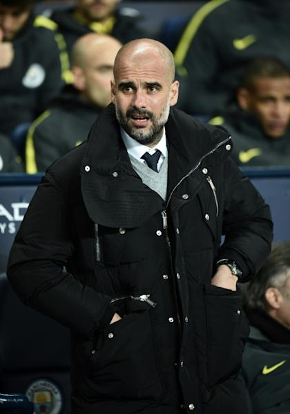 Manchester City's Pep Guardiola watches his players from the touchline on March 1, 2017