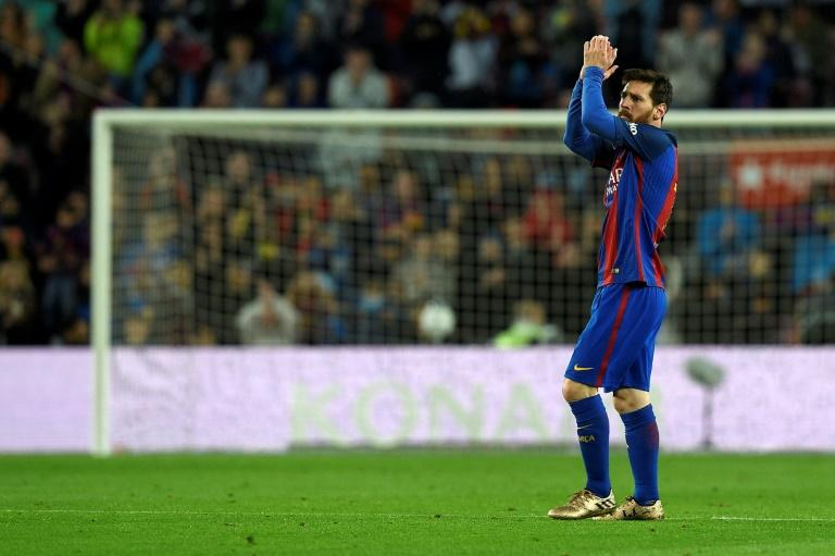 Barcelona's forward Lionel Messi celebrates after scoring a goal during the Spanish league football match against Osasuna April 26, 2017