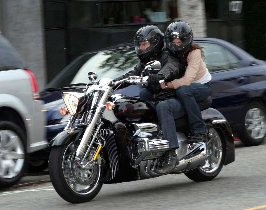 """Katie Holmes holds on tight to her main squeeze Tom Cruise as the couple roars down Robertson Boulevard en route to dinner at The Ivy in Los Angeles. <a href=""""http://www.x17online.com"""" target=""""new"""">X17 Online</a> - June 6, 2005"""