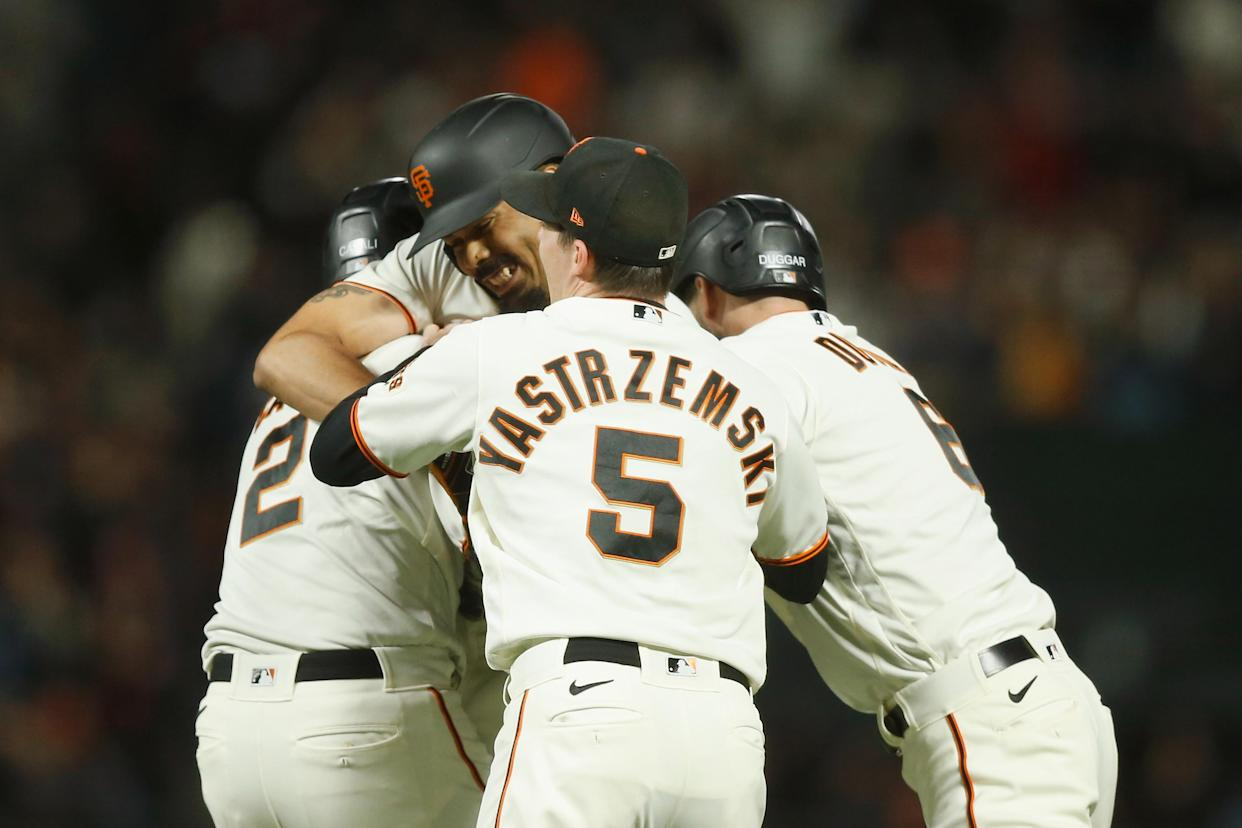 SAN FRANCISCO, CALIFORNIA - SEPTEMBER 30: LaMonte Wade Jr. #31 of the San Francisco Giants celebrates with teammates after hitting a walk-off RBI single in the bottom of the ninth inning to beat the Arizona Diamondbacks at Oracle Park on September 30, 2021 in San Francisco, California. (Photo by Lachlan Cunningham/Getty Images)