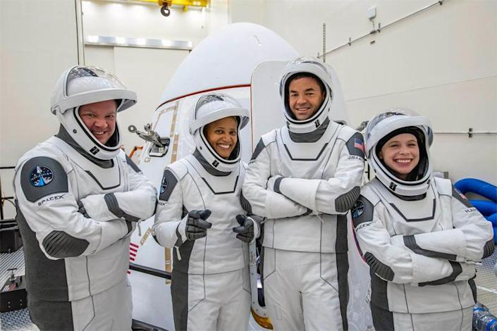 The Inspiration4 crew, checking out their SpaceX pressure suits while visiting the Crew Dragon capsule that will carry them into space on the first all-civilian flight to orbit. Left to right: Chris Sembroski, Sian Proctor, commander Jared Isaacman, Hayley Arceneaux. / Credit: Inspiration4